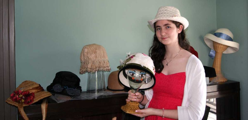 Emily Simon, HGHS Senior Experience intern developed an exhibit on the History of Hats