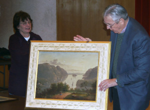 Jack McAuliffe appraises a local resident's painting.